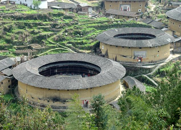 A view of two round earthen buildings