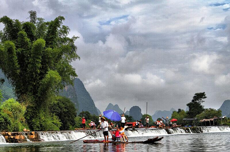 An activity one cannot miss during the Yangshuo tour is rafting on Yulong River