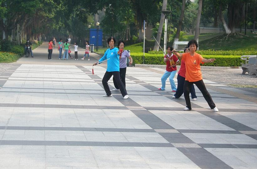 Locals play Tai Chi in Nanhu Lake Park of Nanning, capital city of south China's Guangxi Province
