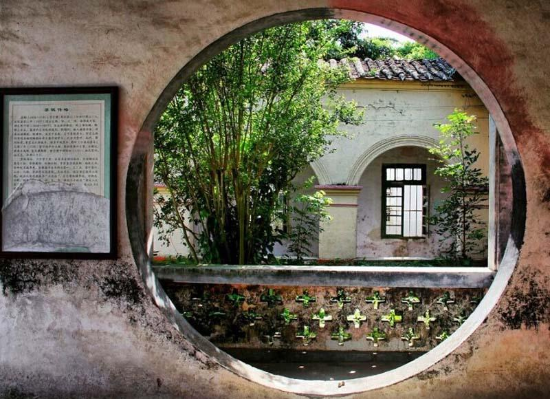 Scenery out of the round window of Dongpo Pavilion in Beihai, China