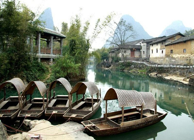 Tourists can take small boats on the rivers of Huangyao Ancient Town