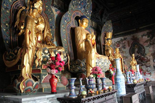 The Buddhas enshrined in the temple.