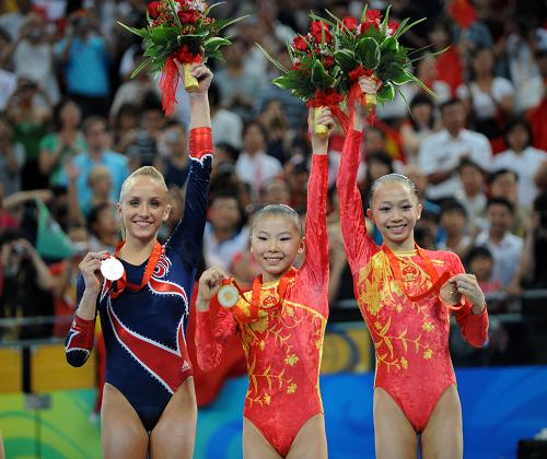 Chinese He Kexin wins uneven bars gold