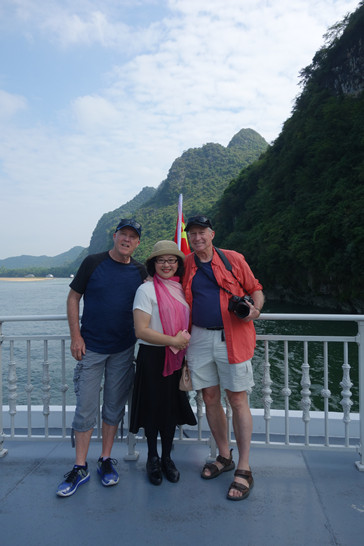 Myself, a tourist, and Jay on the Li River