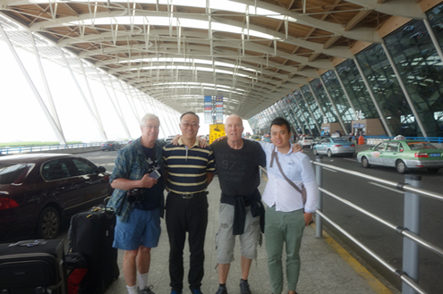 Photo with the driver and tour guide in Shanghai