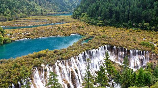 Quake-shattered Jiuzhaigou reopens to independent tourists