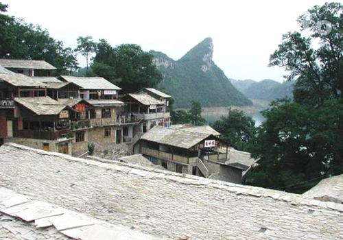 Zhenshan Ethnic Village in Guiyang features its primitive stone houses and ethnic minority customs.