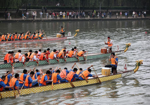 Dragon boats race on Qinhuai River in Nanjing