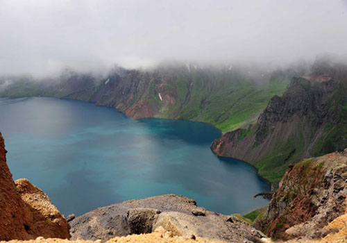 Tourists view Tianchi Lake on Changbai Mountain, NE China